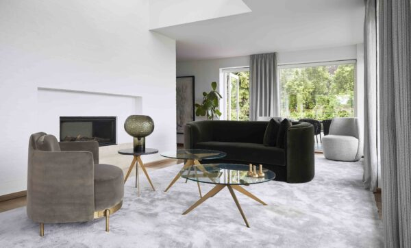 Luxury Home Interiors Light Living Room, with sofa, chairs, tables and rugs